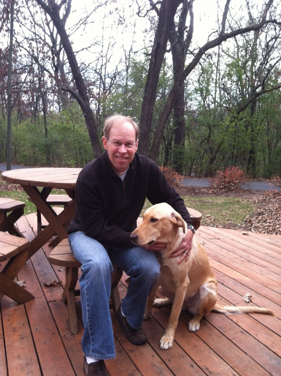 Bruce and our dog Lilly on our front deck,  she is a Yellow Lab mix 95 lbs, about 3 years old and adopted. Who resuced who?